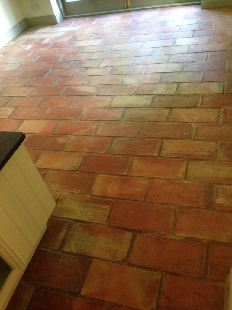 Terracotta brick tiled floor before cleaning in Alderly Edge
